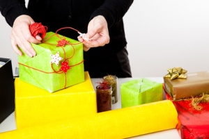 Woman bagging Christmas gifts